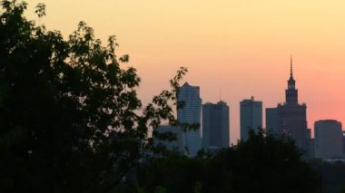 City of Warsaw downtown skyline at sunset in Poland. — Stock Video