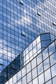 Perspective view to steel blue glass building skyscrapers — Stock Photo