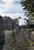 Corridor of electrified barbed-wire fences in Auschwitz II-Birkenau camp in Brzezinka, Poland.  — 图库照片