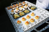Tray with appetizers — Stock Photo