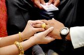 Bride wears wedding gold ring groom — Stock Photo