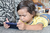 Little boy with a smartphone — Stock Photo