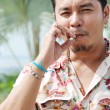 Closeup portrait of handsome smoking young man — Stock Photo