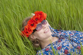 Girl lying in meadow — Stock Photo