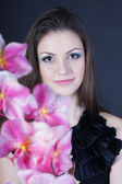 Girl with an orchid — Stock Photo