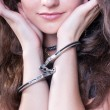 Slave girl in handcuffs — Stock Photo