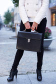 Girl with a leather briefcase. — Stock Photo