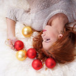 Girl with Christmas balls. — Stockfoto
