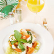 Classical Italian salad with vegetables on the plate - ストック写真