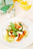 Classical Italian salad on the plate — Stock Photo