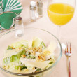 Caesar salad in a glass dish — Stock Photo