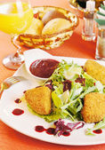 Fried cheese Camembert with cranberry sauce — Stock Photo