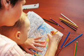Mother is teaching a son to draw — Stock Photo