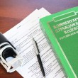 Russian civil code book and blank form of a contract — Stock Photo #14524053