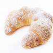 Freshly baked bun dusted with sugar powder — Stock Photo