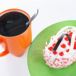 Cup of coffee and sweet cake on a green plate - Stock Photo