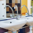 Nursery washbasins in a bathroom of kindergarten — Stok fotoğraf