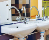 Nursery washbasins in a bathroom of kindergarten — Стоковое фото