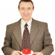 Man holds a small gift with ribbons — Stock Photo #19654011