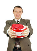 Man gives a gift — Stock Photo