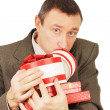 Weary man with a lot of presents — Stock Photo