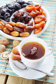 Dried Fruits And Cup Of Tea — Stock Photo