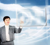 Woman Pushes Touch Screen Buttons Against Blue Natural Background — Stock Photo