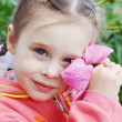 Beautiful Little Girl in Garden with Peony Flower — Stock Photo #27446929