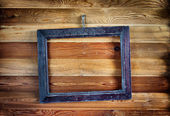 Old vintage wooden frame hanging on the wall — Stock fotografie