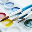 Three paintbrushes and set of various watercolor — Stock Photo