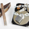 Hard disk drive and rough tools. Concept of hacking — Stock Photo
