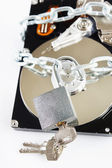 Unlocked padlock and chained hard disk drive — Stock Photo