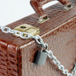Stock Photo: Chained suitcase with padlock