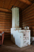 Old brick furnace in a corner of the house — Stock Photo