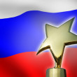 Gold star award against Russian flag — Stock Photo