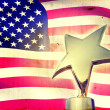 Gold star award against vintage USA flag — Stock Photo