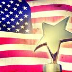 Gold star award against vintage USA flag — Stock Photo