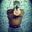 Robber with a gun — Stock Photo