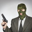 Man wearing mask with a gun — Stock Photo