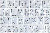 Alfabeto. lettere e cifre scritti sulla neve — Foto Stock