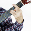 Stock Photo: Mplays chord on guitar