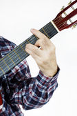 Man plays a chord on the guitar — Stock Photo
