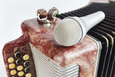 Microphone lying on a harmonica — Stock Photo