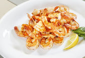 Lots of shrimp on a plate — Stock Photo