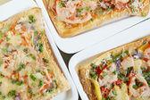 Three fresh pizzas on plate — Stock Photo