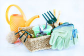 Composition with gardening tools and watering can — Stock Photo
