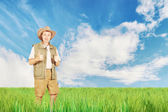 Bright summer landscape with a happy man on the field — Stock Photo