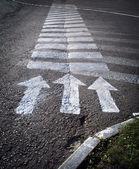 Arrows on the crosswalk — Stock Photo