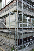Scaffolding set during building renovation — Stock Photo