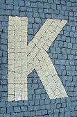 Calçada de pedras com letras — Fotografia Stock